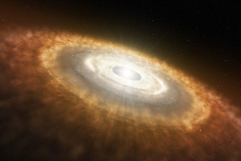 Młoda gwiazda otoczona dyskiem protoplanetarnym. Rys. ESO/L Calçada