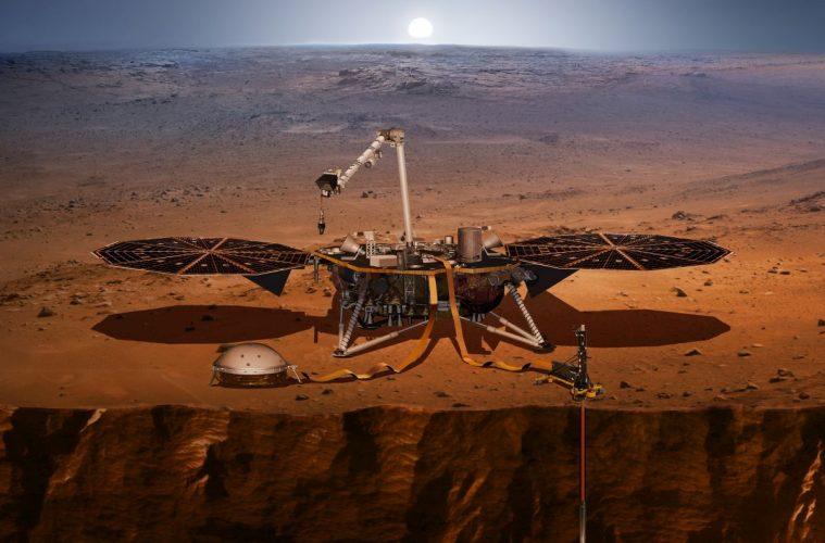 Wizja lądownika InSight na powierzchni Marsa. Po prawej widać Kreta wbitego w grunt. Po lewej, pod ochronną kopułą, przyrząd SEIS czyli sejsmograf. Rys. NASA/JPL-CALTECH